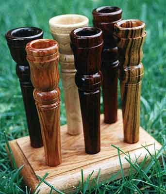 Mouthpieces in Exotic Hardwoods: (clockwise from front) Tulipwood, Zircote, Lilac, Cocobola, Zebrawood, Vietnamese Rosewood)